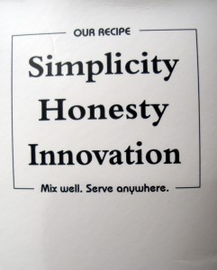 """A sign that says """"Our recipe: Simplicity, Honesty, Innovation. MIx well. Serve anywhere."""""""