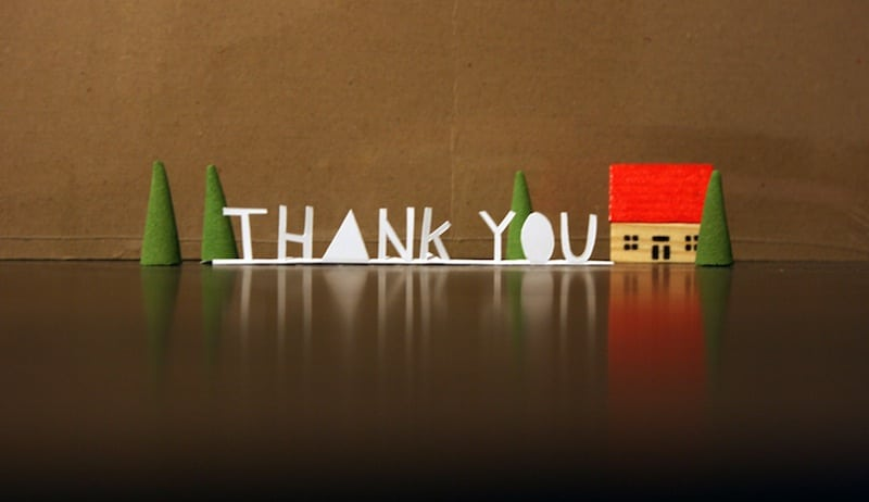 """Picture of figures spelling out """"thank you""""."""